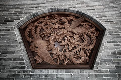 Wall Sculpture of two flying chinese swans surround with flowers. The wall Sculpture of two flying chinese swans surround with flowers at Xian, China Royalty Free Stock Photo