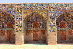 The wall of Shah Mosque (Imam Mosque) on Naqsh-e Jahan Square in Isfahan city, Iran. Stock Images