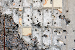 Wall Shattered With Bullets Stock Photo