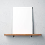 Wall with shelf and blank poster. White concrete wall with shelf and blank poster royalty free stock photos