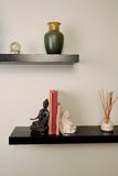 Wall shelves. Wood shelves featuring simple home decor Royalty Free Stock Photos