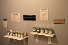 Wall with shelves of containers, filled with smells for visitors to guess, Brick Store Museum,Kennebunk,Maine,2016. Interesting exhibit with shelves on wall in stock image