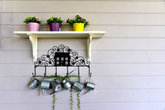 Wall shelves for decoration. Wall shelves, vases and flowers for decoration Royalty Free Stock Photo