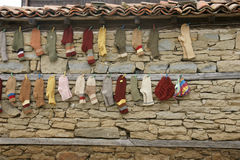 Wall showcase - 18. Handmade goods on the wall of a village house in the mountains of Bulgaria in the autumn Royalty Free Stock Image