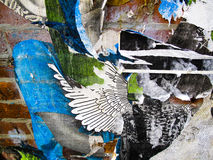 Wall with shreds of paper and graffiti Royalty Free Stock Image