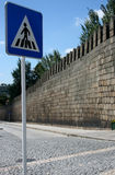 Wall and sign. Pedestrian traffic sign and middle age stone wall Stock Photo