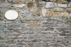 Wall with sign Stock Photography
