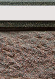 Wall sign. Empty sign on a granite wall (ready for your design Royalty Free Stock Images