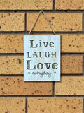 Wall sign saying `live laugh love everyday` Royalty Free Stock Photography