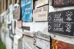 Wall with signboards Stock Images