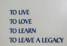 Free Wall Signs Words To Live Love Learn Legacy Outdoors Stock Photo - 163817930