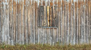 The wall of the simple village barn is made of upright rotten pi. Ne boards. Sunny autumn day panoramic collage Royalty Free Stock Photography