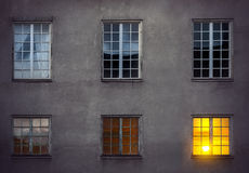 Wall with six windows Stock Images