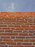 Wall & sky. Red brick wass with a portion of blue sky Royalty Free Stock Photos