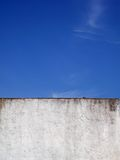 Wall and sky. Part of old white wall and clear blue sky Royalty Free Stock Photography