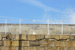 Wall with sky and railing. Simple composition with sunlight, blue sky, stone wall and railing Royalty Free Stock Photos