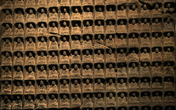 Wall of small antique Buddha images. Portrait of a antique buddha statue Royalty Free Stock Photos