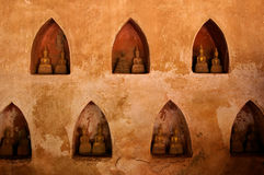 Wall with small Buddha statues Royalty Free Stock Image