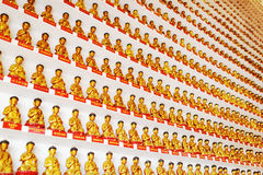 Wall with small golden Buddha statues inside the temple of the T Royalty Free Stock Photos