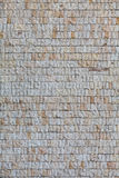 Wall with small grey granite tiles Royalty Free Stock Photography