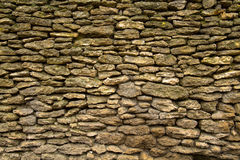 Wall of small stones Stock Images