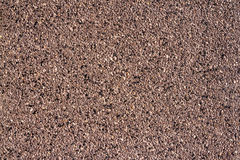 Wall of small stones texture. Pebbles and sand wall texture. Small stones wall background for design with copy space Royalty Free Stock Photos