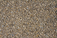Wall of small stones texture. Pebbles and sand wall texture. Small stones wall background for design with copy space Stock Photo
