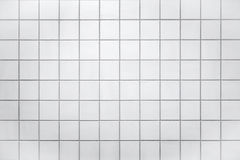 Wall with small white tiles Royalty Free Stock Image