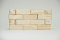 Wall of small wooden bricks. Hand-made master. Photo on a white background. Macro Royalty Free Stock Image