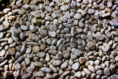 Wall of smooth stones Stock Images