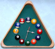 Wall snooker clocks. Wall clock in snooker hall in triangle frame shape Stock Photo