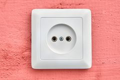 Wall socket European type, square shape, white, close-up. Stock Images
