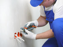 Wall socket installation Stock Photos