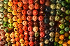 Wall of Spray Paint Cans. Wall of colorful spray paint cans artistic background royalty free stock photos