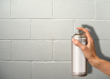 Wall spraying. Female hand using a spray cannister on a wall Stock Image
