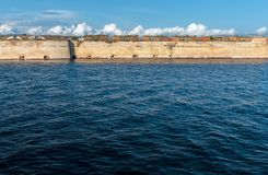 St Nicholas Fortress at sea. Wall of St Nicholas Fortress at wavy sea surface, Åibenik, Croatia stock photo
