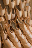 A Wall of Stacked Pink Satin Ballet Slippers. And point shoes in the theather district of Covent Garden, London , England Royalty Free Stock Photo