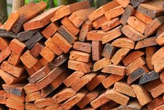 Wall of stacked red clay bricks for construction site.  Stock Photo