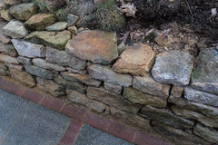 Wall of stacked stone slabs. Royalty Free Stock Photo