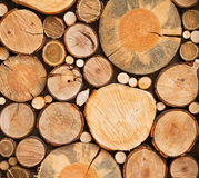 Wall of stacked wood logs as background, texture. Royalty Free Stock Images