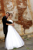 Wall Stand. A wedding couple standing close together Royalty Free Stock Photography