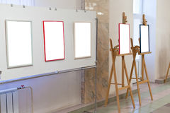 Wall stand in art gallery hall. With cut out picture frames Royalty Free Stock Images