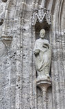 Wall statue of Franciscan Church in Salzburg, Austria stock images
