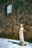 Wall statue goddess in the sun. stock photography