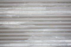 Wall of steel rolling door. Stock Photo