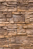Wall of stone. Wall revetted with flat stones Stock Image