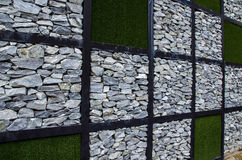 Wall of stone and artificial grass Stock Photography