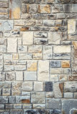 Wall with stone blocks stock images