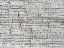 Wall of stone blocks as a grunge background Royalty Free Stock Photos