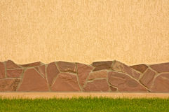 A wall with a stone border. Wall with a stone border and green grass Royalty Free Stock Image